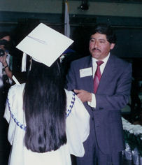 Manuel speaking to graduation student